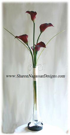 Google Image Result for http://sharonnagassardesigns.com/WeddingCenterpieces/EiffelTowerCenterpieceMedium.jpg