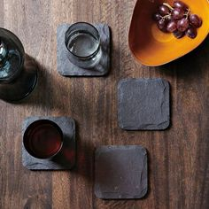 """$16 black slate coasters. """"Chalk them up with your guests' names, then erase and repeat for your next party."""""""