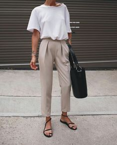 Outfit idea. White tee tucked into trousers with flat sandas