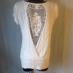 Charlotte Russe Top White top with open crochet back. Charlotte Russe Tops Blouses