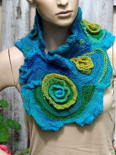 Crochet Scarf - Capelet. Unique scarf made Freeform method. Warm and pleasant to the touch. Beautiful unique design. Color: shades turquoise,blue,green,pistachio  Size: One size fits all  materials used:100% acrylic  Care instruction: hand wash using warm water.  Because of different monitors and screen resolutions, colors may look different on the screen than really.