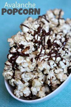 Avalanche Popcorn Recipe - a peanut buttery- coated popcorn drizzled with chocolate, from RecipeBoy.com