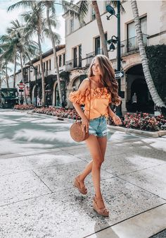 Orange ruffle off-the-shoulder top + distressed denim shorts