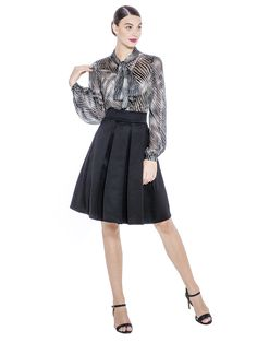 An A- line shaped skirt with soft pleats and hidden pockets is made from a designer imprinted fabric, it is hand picked from Italy and has a luxurious feel and touch. This skirt will equip you elegantly for the office or an event. Fabric imported from Italy: 75% Acetate 22% Nylon 3% Elastane  Lining imported from Germany: 57% Viscose 40% Polyimide 3% Elastane  Washcare: Dry clean MADE IN EUROPE