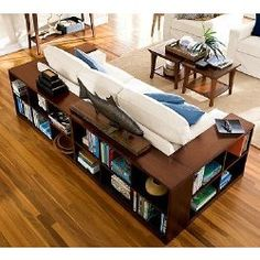 Wraparound Console = BOOKSHELVES! Love this for exposed back of sofa!