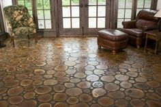 """Americana at its finest, this rustic flooring from Chicago-based Birger Juell is almost like a modern day tribute to the log cabin. Each of these """"tiles"""" is a cross-section from the leftover ends of a tree trunk or branch. Although each round is sanded and then oiled for protection, the natural wearing of the wood still allows for occasional minor splits and cracks, which only adds to the floor's personality."""