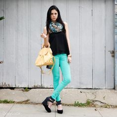 Leopard scarf, black shirt, bright blue pants & simple black shoes.