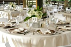 White and Green Hydrangea Wedding Centerpiece by Bluegrass Chic - Rustic Wedding at the Delamater House  - New Smyrna Beach FL wedding venue - Photo: Bumby Photography - Orange Blossom Bride - Click pin for more - www.orangeblossombride.com
