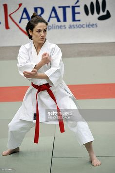 French deputy minister for Ecology and former Karate-kata French champion Chantal Jouanno competes in the French Karate team championships on March 2010 at the Pierre de Coubertin in Paris. Karate Kata, Self Defense Techniques, Karate Girl, Martial Arts Women, Brenda Song, March 7, Martial Artist, Aikido, Action Movies