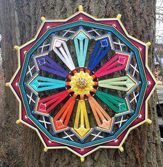 "Mandala Ojo de Dios ""12 Months"". You can order this mandala https://www.facebook.com/jevgenial"