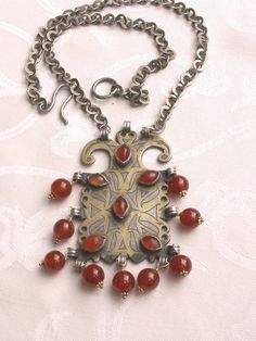 by Anne Marie of BeadArt Austria | Necklace. She has replaced all of the missing pendants off this lovely antique Turkoman goldwash silver pendant with carnelian beads and added a heavy silver chain. SOLD