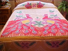 Plush 50's chenille bedspread with yellow background and 2 red peacocks