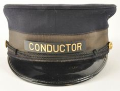 """Conductor's Cap for the Union Pacific Railroad with Union Pacific Marked buttons on either side of black rope band with plastic """"Conductor"""" badge. Manufacturer marked inside Ruby's Uniform Caps 205 W. Madison St Chicago. Cap shows no signs of being worn. size: 8"""