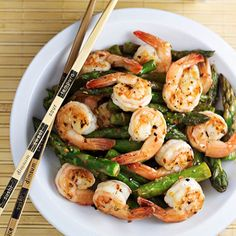 """Ingredients 4 tablespoons olive oil, divided 1 pound large raw shrimp, peeled & deveined 1 pound asparagus, ends trimmed and each stalk cut into 2-3"""" pieces ½ teaspoon salt, divided 1 teaspoon minced ginger (Gourmet Garden Ginger Paste) 1 teaspoon minced garlic Lemon Sauce ⅔ cup chicken stock 1 tablespoon…"""