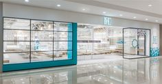 Several white materials with different textures are shown in the open store space that is dotted with blues, adding interest and sense of layers in the bright, neat and cozy space.