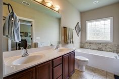 Traditional Master Bathroom with Avalon Cabinet Door Style By Aristokraft, Flat panel cabinets, Double sink, High ceiling