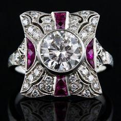 antique design, modern make.  1t diamond center with rube and diamond accent.  Pretty.