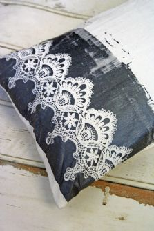 hand screen printed cushion features a beautiful lace design.  I love the messiness of the print which makes each cushion unique.  The screen print is in a gorgeous glittery gun metal and the cushion itself is a beautiful off white/cream.