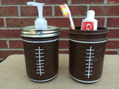 Football Bathroom Set! This 2 piece set is perfect for a Sports themed bathroom. Great gift for any Sports fan, Christmas gift, or Fathers Day gift! Includes: 1 Pint Wide Mouth Soap Dispenser 1 Pint Wide Mouth Toothbrush Holder.  These jars are hand painted on the outside. White stitching is added for the Football look and sealed. **These are made to order, so please allow 5-7 days for your jars to be painted and sealed.**  (Items in jars not included)  ***Do Not wash in dishwasher or…