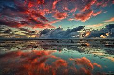 Red clouds, mirrored lake.