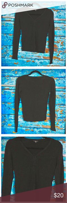 Long Sleeve Lace Up Grunge Goth Soft Crop Top Picture has been lightened to show lace up front and texture of Shirt. Last picture is untouched showing how dark the black color actually is. Super soft stretchy material. Lace up Tie front. Size L Zn Tops Tees - Long Sleeve