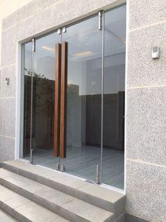 Glass door with wooden handle