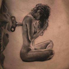 Wind up female tattoo