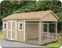 giant dog kennel and storage ~ we'll be remodeling an old shed and transforming it into this kennel for our Newfoundlands this spring.  Adding window boxes, some landscaping & a few other finishing touches to make it homey.