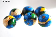 Blue Flower Beads with White Swirls on Yellow Jewelry Making Supplies Polymer Clay Beads - pinned by pin4etsy.com