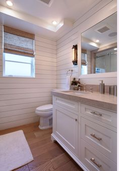 The interior channel siding combined with Edison wall sconce create a modern take on a rustic powder room!