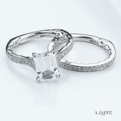 An A.JAFFE emerald cut diamond engagement ring and band.