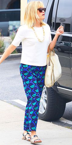 Love Her Outfit! | REESE WITHERSPOON | If you typically wear jeans with a printed top, try flipping the combo like Reese does with her boxy Three Dots shirt in cream and geometric-print bottoms. Neutral accessories (yes, we consider the silver on her Sam Edelman sandals a neutral) keep the focus on the pants.