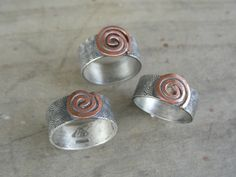 copper Spiral on Spiral etched silver ring. $52.00, via Etsy.