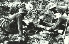 VERDUN 1916-2016: During the battle around Verdun in 1916, three German soldiers help a Frenchman out of the bottomless mud.
