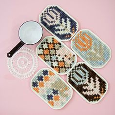 Hand-embroidered potholder backed with organic cotton. Design inspired by cross-stitch motifs.