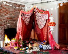 Use light pieces of cloth, scarves or sheets to make a romantic fort. The great indoors will never seem more cozy.