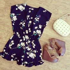 floral romper, brown wedges, and cream clutch