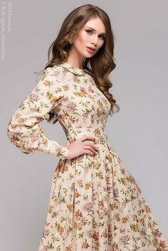 Длинное ванильное платье с цветочным принтом и длинным рукавом 1