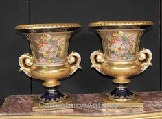 - Gorgeous pair of French Sevres style porcelain vases<BR> - Tall pair stand in at over two feet tall<BR> - Elegant pair ready to add oomph to any interiors scheme<BR> - Main panels show various scenes of 18th century French courtly love<BR> - Please see close up photo of Sevres factory stamp on the underside of these<BR> - Bought from a dealer at Les Puces flea market in Paris<BR> - Please come and view this in our Hertfordshire showroom, just 25 minutes north of London <BR> - Offered in…