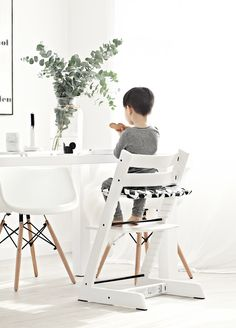 """Tripp Trapp chair and accessories from Stokke –Blogger says, """"The introduction of this chair to our home has given Hayden another milestone.  His eagerness to be independent, doing things by himself lately and this chair sure provides him that opportunity.  He can climb up and sit himself and down again!"""" via Mae Gabriel"""