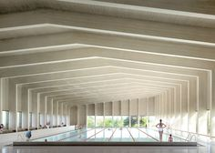 A cross-laminated timber roof covers this six-lane swimming pool, which London firm Hawkins\Brown is to add to a school in Surrey