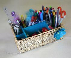 DIY pen basket using duct tape and cardboard.