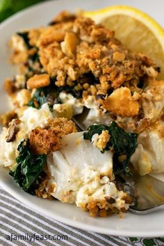 Baked Cod with Boursin - An incredible fish dinner!  Super moist fish topped with Boursin cheese, spinach, mushrooms and a cracker topping!