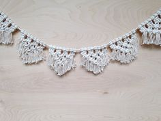 The garland is handmade using 100% cotton rope. Sold in lengths of 3 feet long. This would be perfect for decorating a special occasion or just in your home