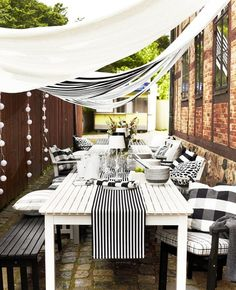 outdoor dining for small yard-- like the idea of a bench lining the neighbors wall and then you could have dining out there or just relaxing
