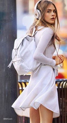 Cara is so gorgeous with white long sleeves shirt, white airy skirt, white cute backpack, and put the music on.