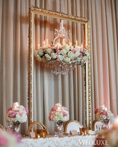 Who doesn't love a little #rosegold? This head table was given a rosy treatment courtesy of a massive, ornate frame backdrop with a stunning suspended #floral-covered #crystal #chandelier. See more from this #wedding on WedLuxe.comtoday! | Photography by: Butter Studios Events, planning: Dream Group Planners, decor and floral: Koncept Events, Flowerz Inc. | WedLuxe Magazine | #wedding #luxury #weddinginspiration #floral #eventdesign