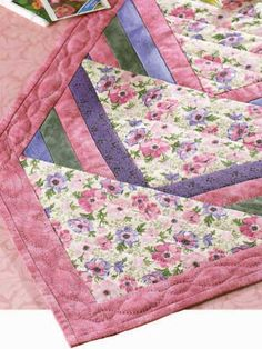 Spring Flower Runner-Make a simple, quilted table runner with fabric strips, triangles and one large square. Finished table runner size is approximately x 16 Designed by Marian Shenk Table Runner And Placemats, Table Runner Pattern, Quilted Table Runners, Lap Quilts, Small Quilts, Mini Quilts, Patchwork Quilting, Quilting Ideas, Quilting Projects