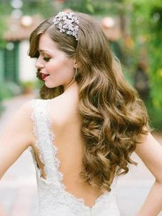 #WeddingHair Perfection. For those with long hair that responds well to a curler and various styling products, we recommend a romantic wavy 'do like this one. It's a perfect way to show off your glamorous side and wedding guests swoon over this wedding hairstyle. Try this out if you're getting married inside, where weather will be less of a factor. {Skyla Arts Makeup & Hair}