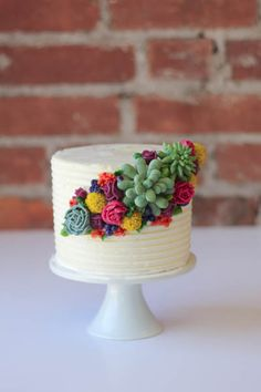 piped buttercream succulents, flowers, and billy balls by erica obrien cake design hamden CT